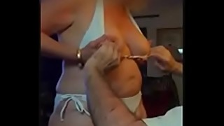 64 YEAR OLD HOTWIFE IN WHITE BIKINI SHOWING OFF TO NEIGHBOR