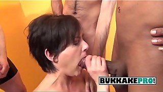 Short haired housewife sucks on multiple cock that cum on her face
