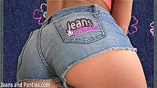 Dark brunette Drian teasing in tight blue jeans