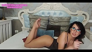 Brunette shows her sexy legs and her juicy feet.