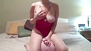 Busty wife in nurse costume rides a plastic cock