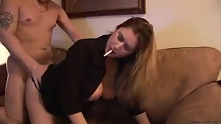 MILF wife smokes and fucks on sofa