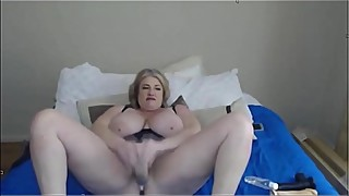 Horny housewife with natural big tits spreads legs and pounds pussy