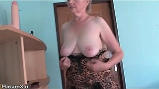 Horny busty mature woman puts her boobs