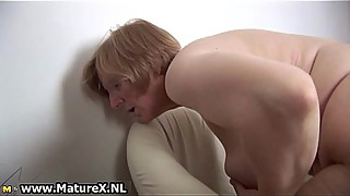 Horny mature woman is pleasuring