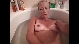 Wife masterbates in tub talks dirty
