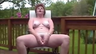 Wife outside filming herself